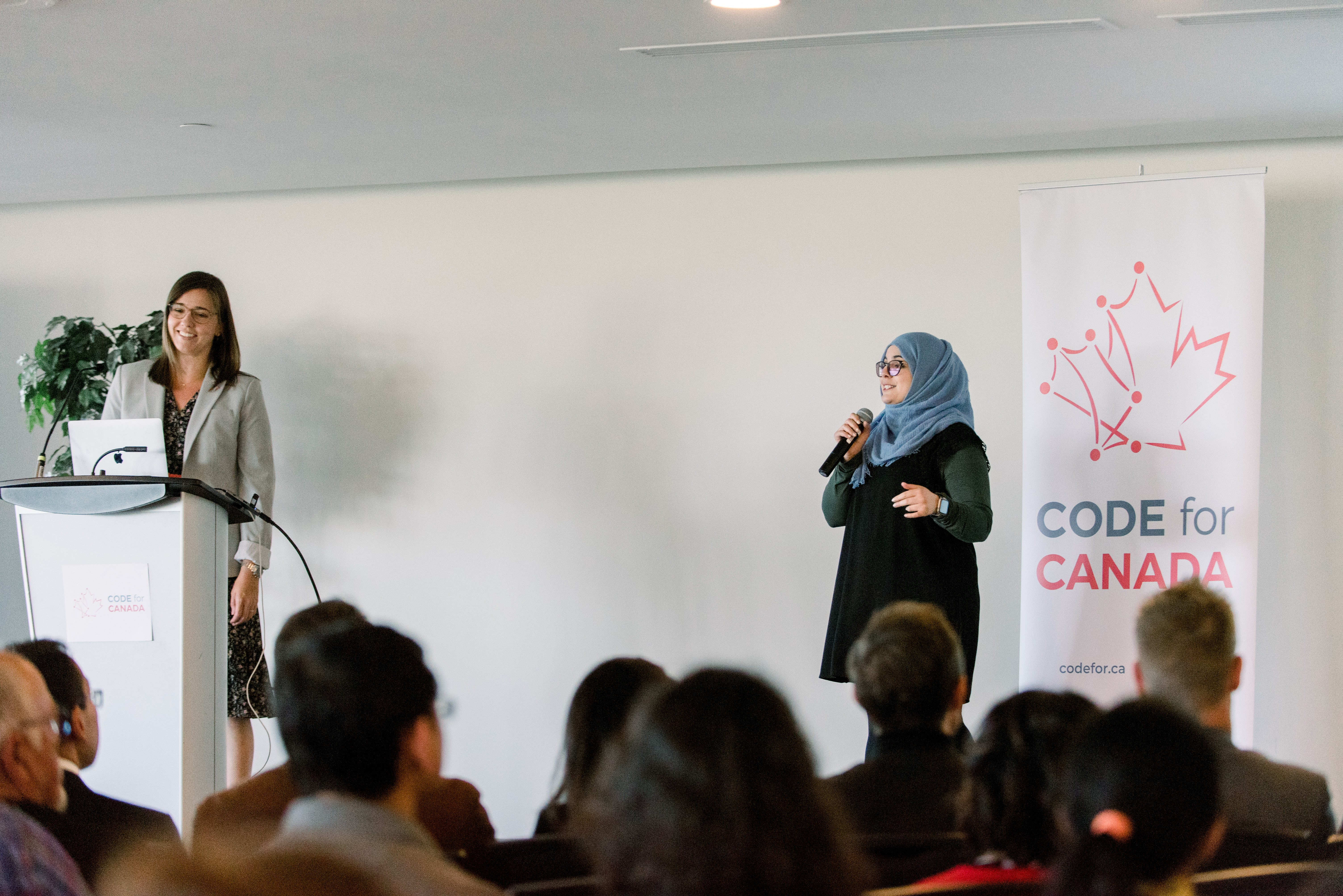 Jeannie Stewart Smith (left) from Transport Canada and Code for Canada fellow Fatima Khalid (right) present at the 2018 Code for Canada Showcase.